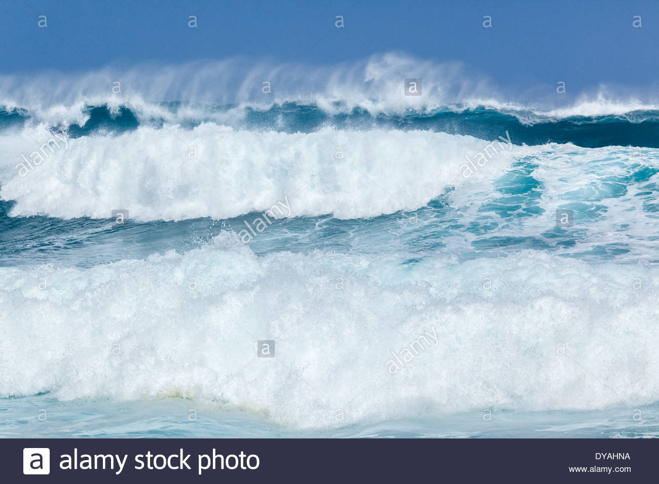 High surf crashing into Hoopika Bay on the island of Maui in the state of Hawaii USA - Stock Image