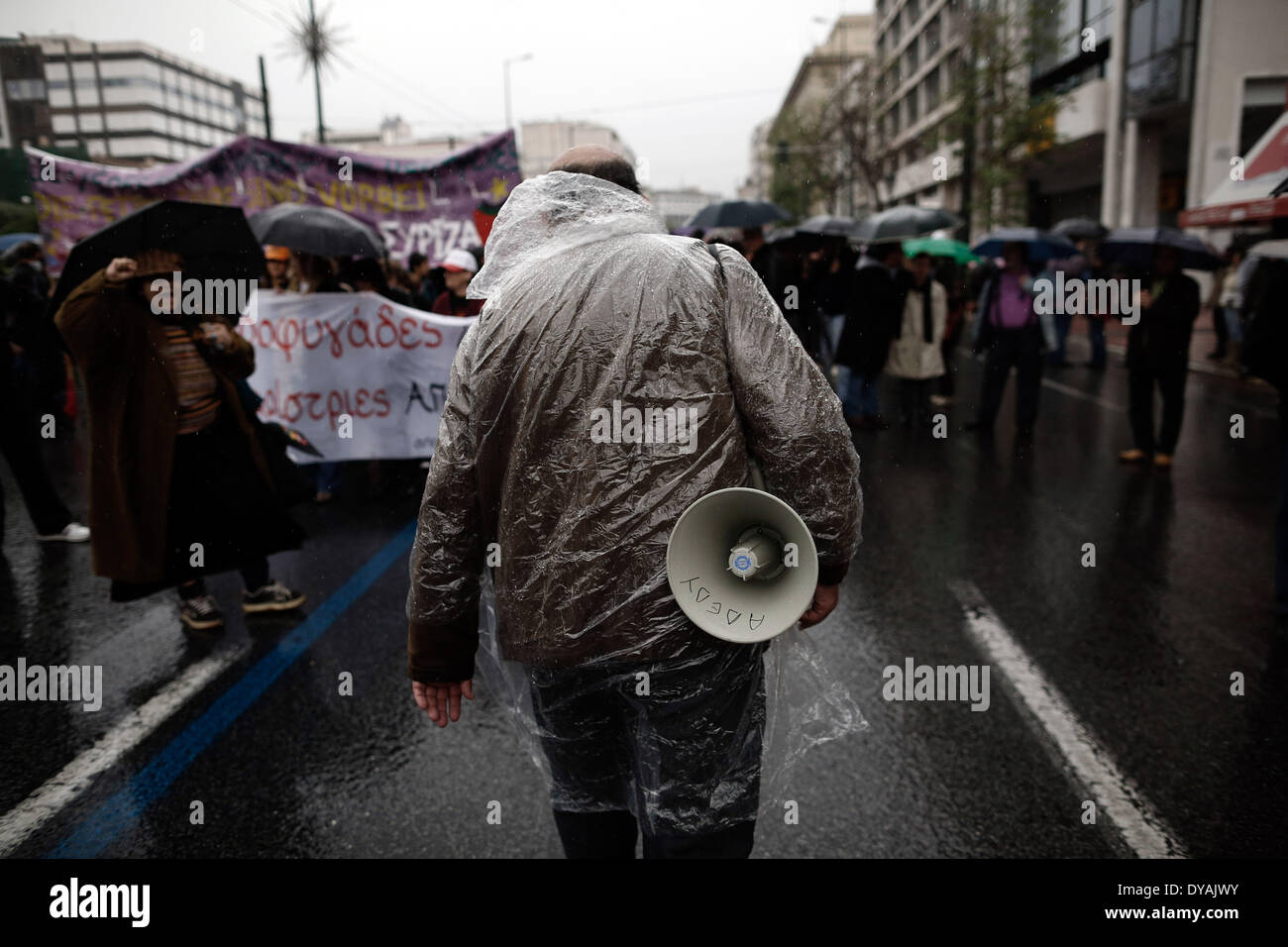 Athens, Greece. 11th Apr, 2014. Protester carries a megaphone during the protest Credit:  Konstantinos Tsakalidis/Alamy Live News - Stock Image