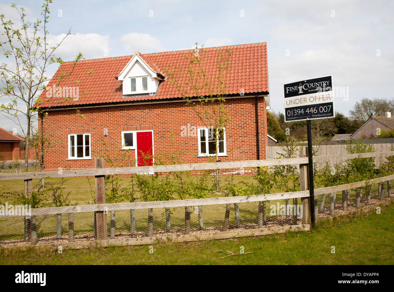 Fine and Country estate agent sign Under Offer outside modern house, Suffolk, England - Stock Image