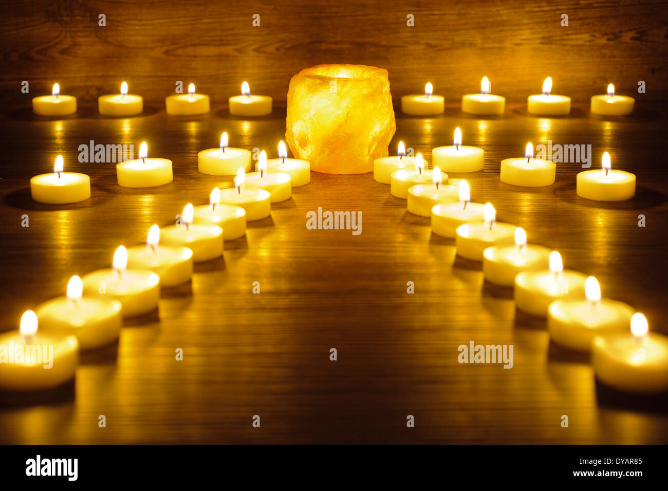garden of meditation with many candle lights - Stock Image