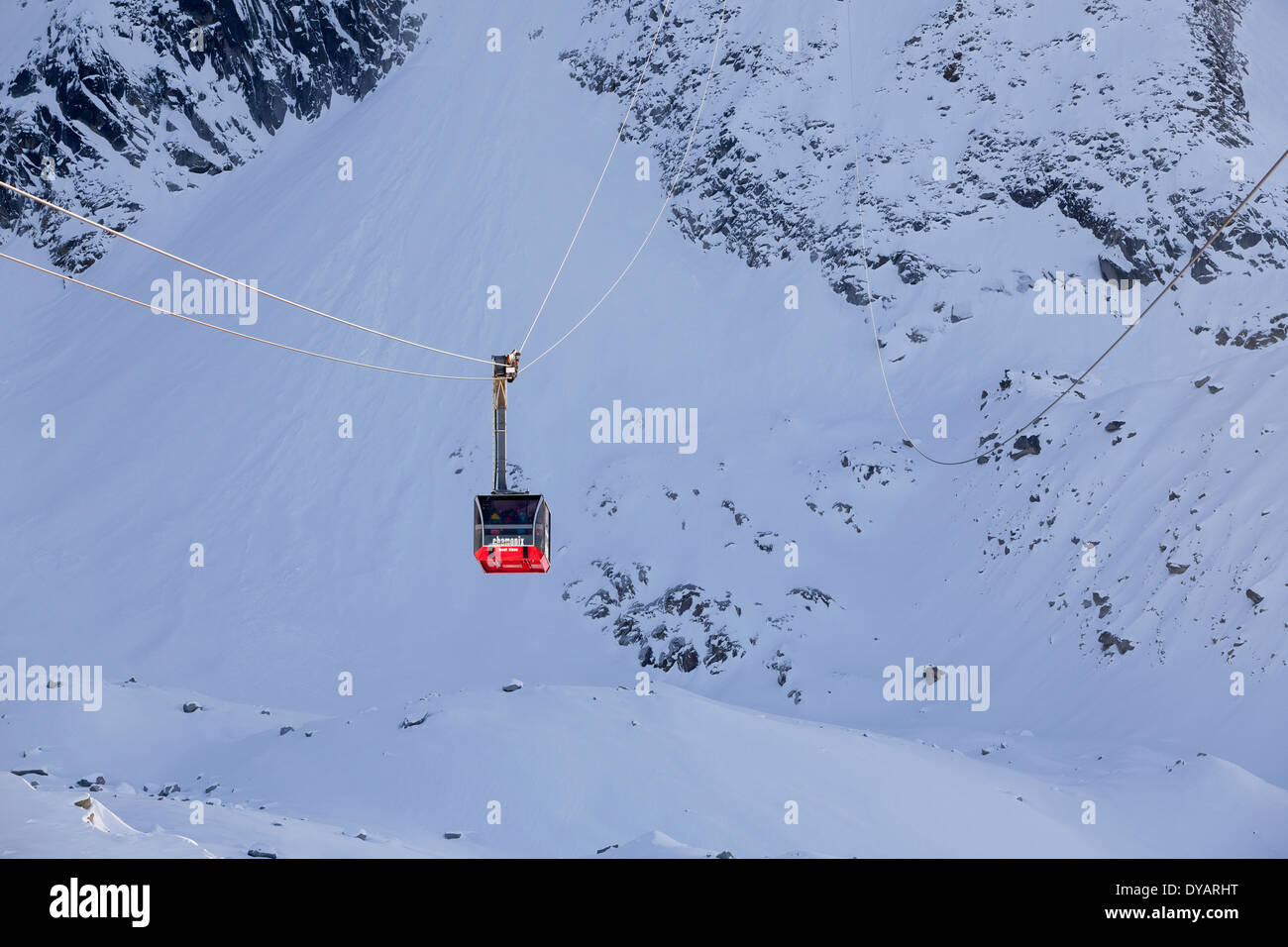 The Aiguille Du Midi gondola, carries passengers to the top of Aiguille Du Midi mountain above Chamonix Mont-Blanc, France. - Stock Image