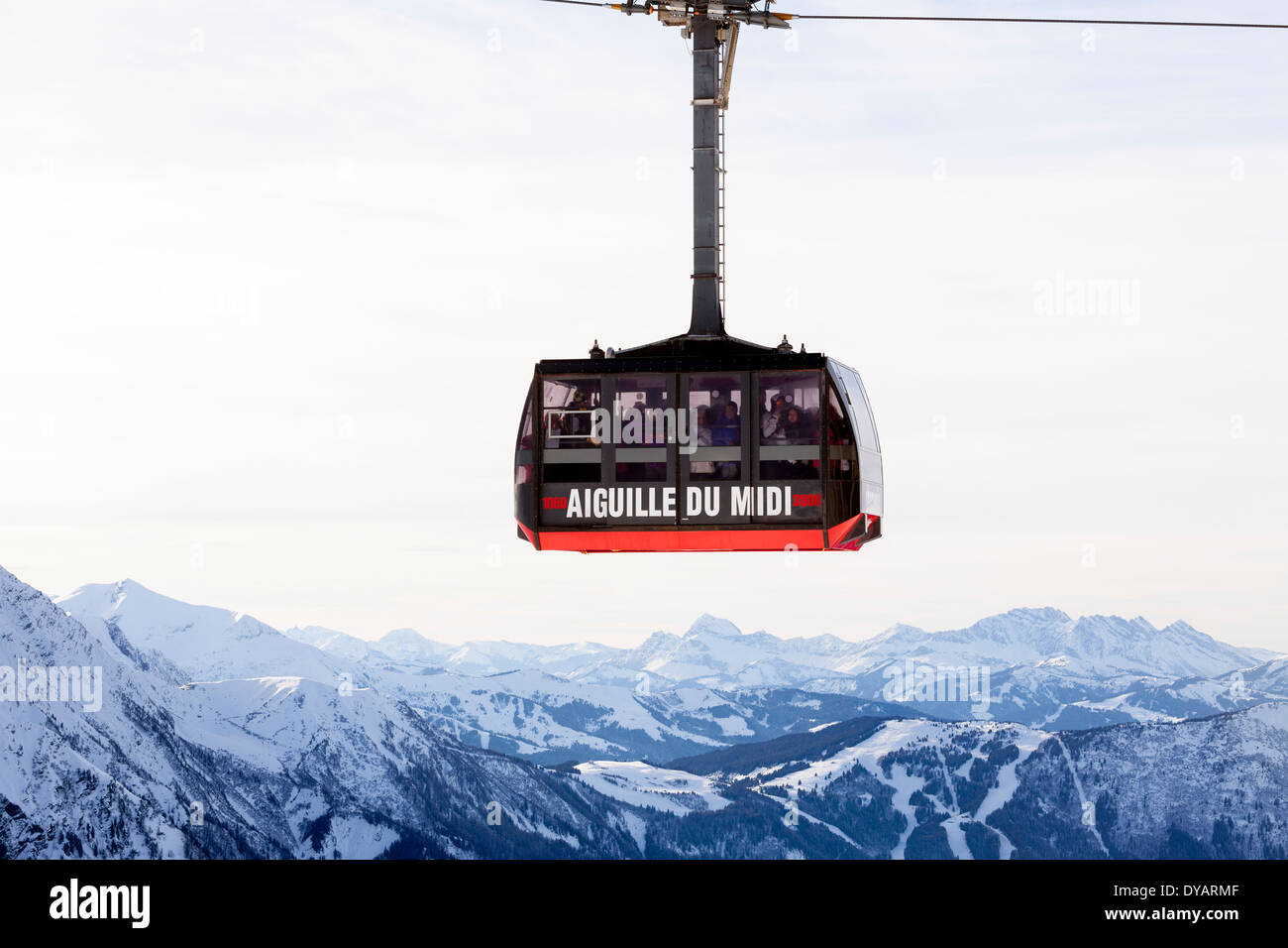 The Aiguille Du Midi gondola, carries passengers to the top of Aiguille Du Midi mountain above Chamonix Mont-Blanc, Stock Photo