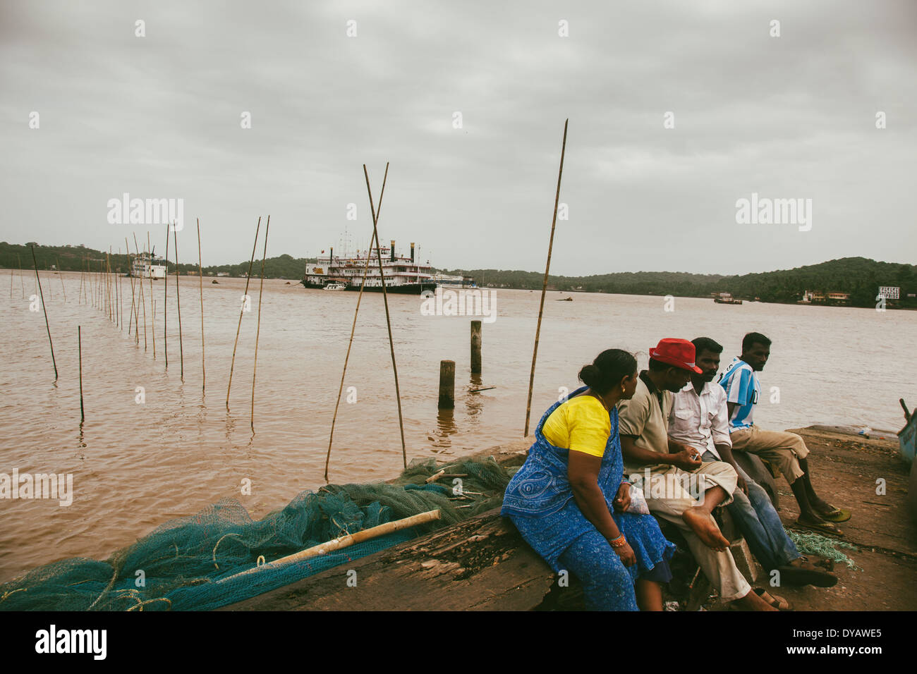 Locals enjoying near the ferry bank in Goa. - Stock Image