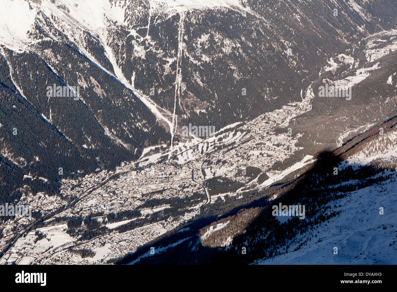 The village of Chamonix Mont-Blanc seen from a lookout point at the Aiguille Du Midi (3842m) mountain top. - Stock Image
