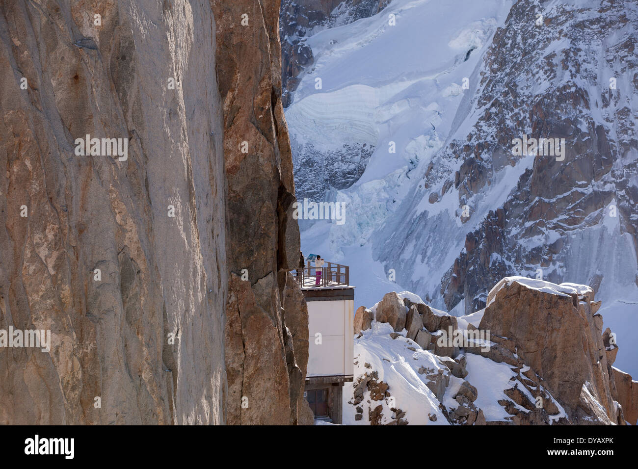 Tourists visit a lookout point at the Aiguille Du Midi (3842m) mountain top above Chamonix Mont-Blanc. - Stock Image