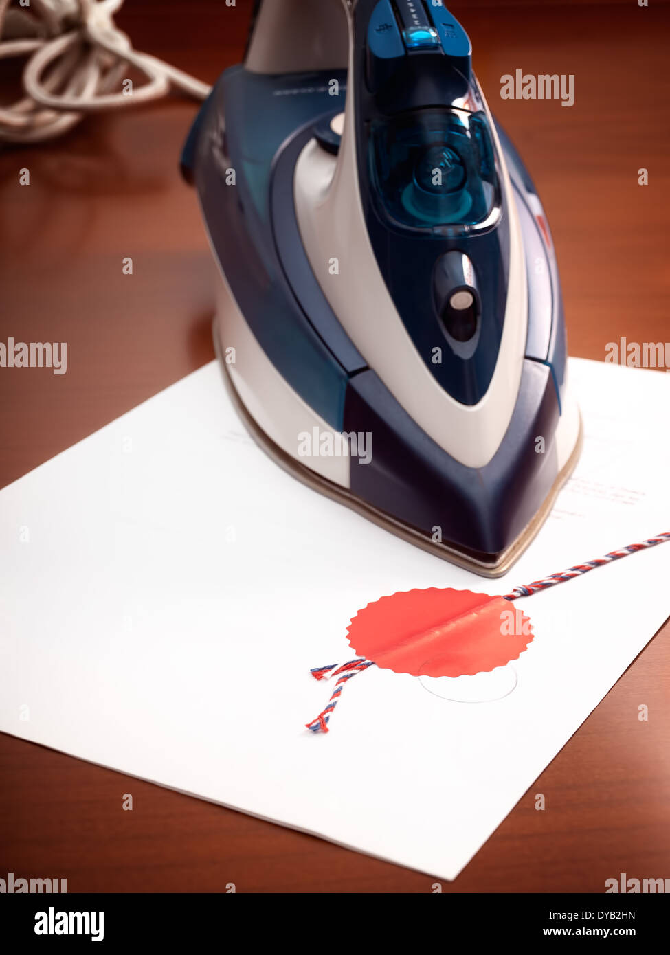 Metaphorical view of changes and modifications in legal agreements, presented with an iron and certified contract. - Stock Image