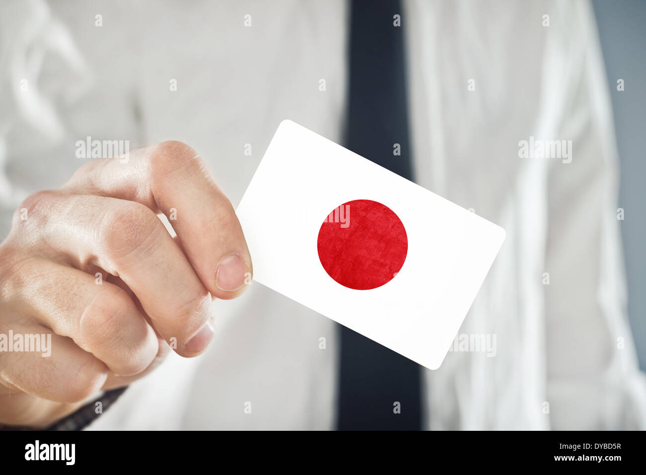 businessman holding business card with japan flag stock image - Japanese Business Card