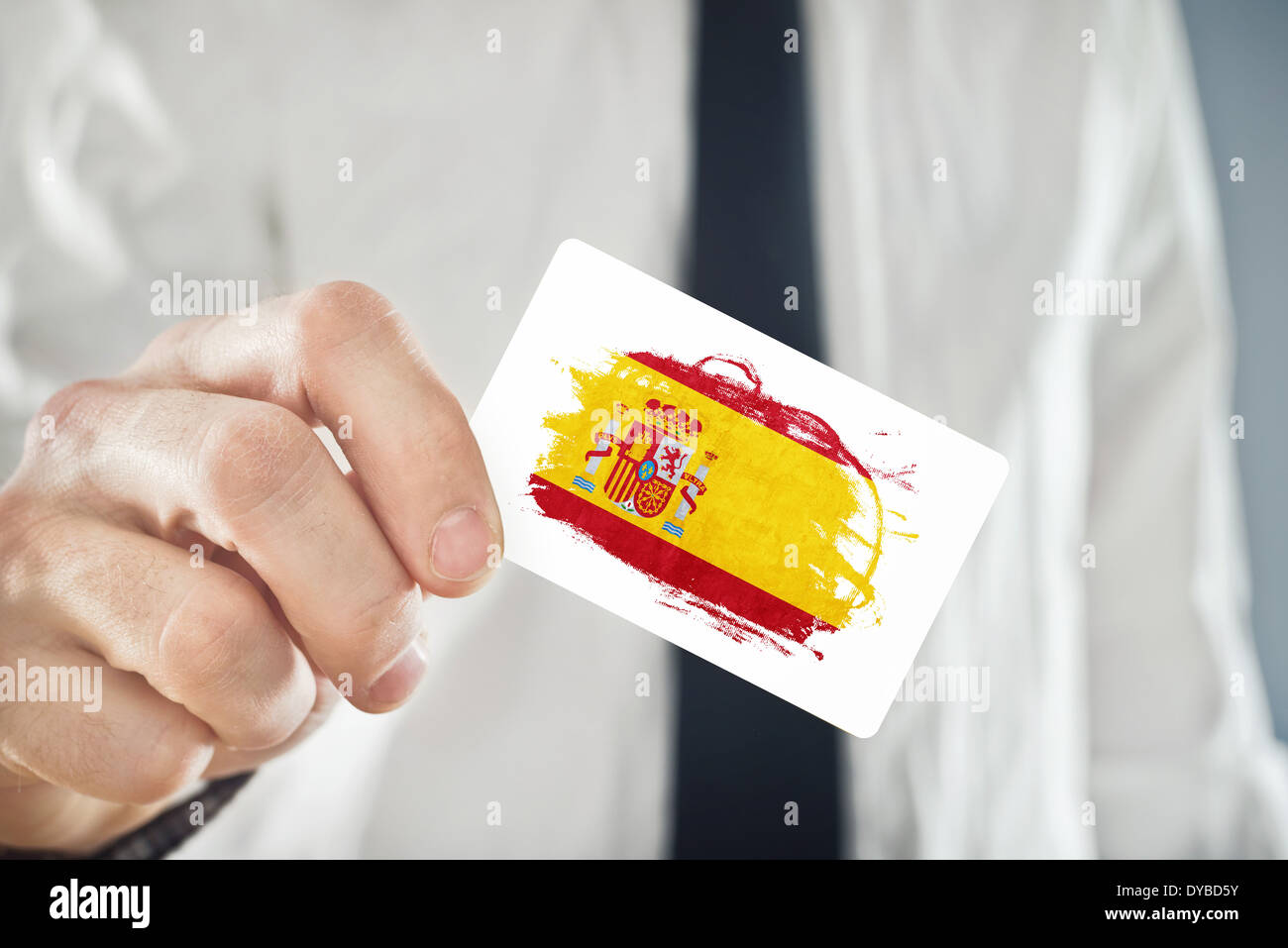 Businessman holding business card with spain flag stock photo businessman holding business card with spain flag reheart Image collections