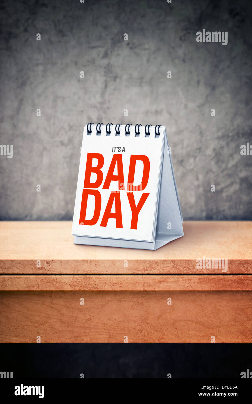 It's a bad day printed on desk calendar at office table. Misfortune concept. - Stock Image