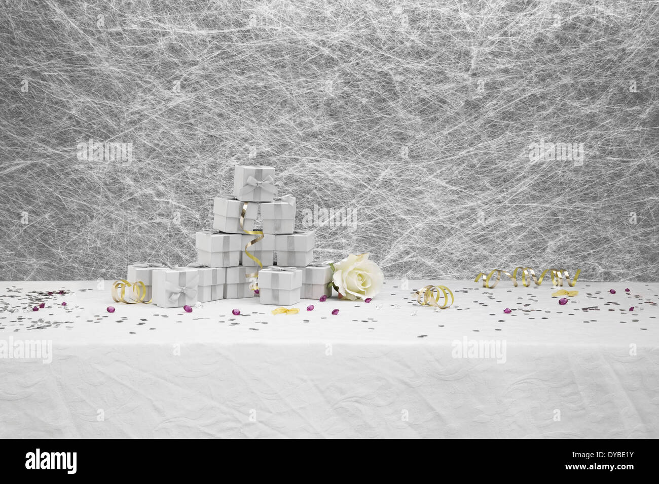 Wedding Favor boxes on a White tablecloth with gold Stock Photo ...
