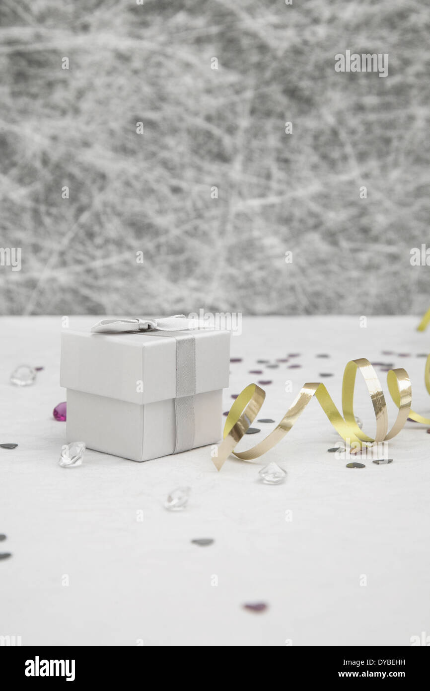 Wedding Favor box on a White tablecloth with gold ribbons,silver ...