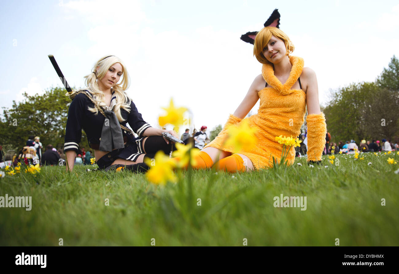 Berlin, Germany. 13th Apr, 2014. The cosplayer Franzsika (L, as 'Babydoll') and Sarah pose during the cherry blossom Stock Photo