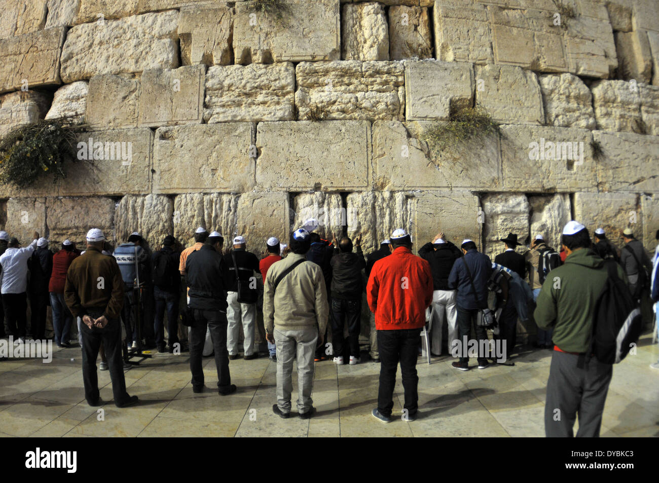 Devotees and worshipers wait to touch the Wailing wall, Old city of Jerusalem, Israel - Stock Image