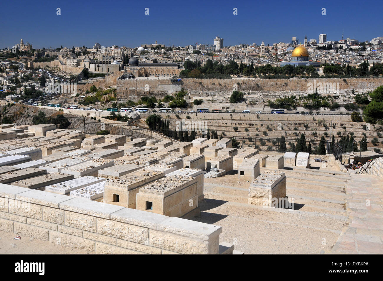 Tombs in the Jewish cemetery of the Mount of Olives and Old city of Jerusalem with  Dome of the Rock mosque, Jerusalem, Israel - Stock Image