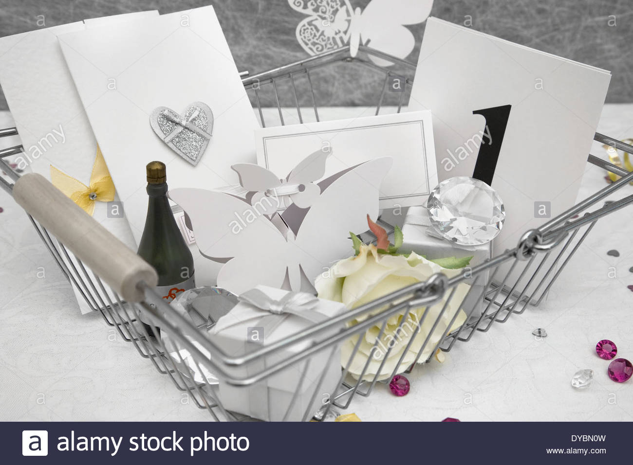 Wedding Favors in a shopping basket on a White tablecloth with Stock ...