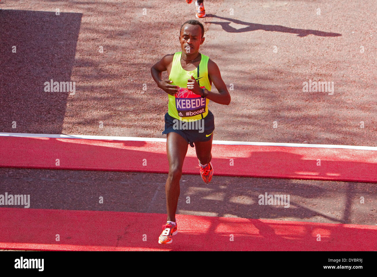 London, UK. 13th April, 2014. Tsegaye Kebede crossing the finish line of the London Marathon 2014  Credit:  Keith Larby/Alamy Live News - Stock Image