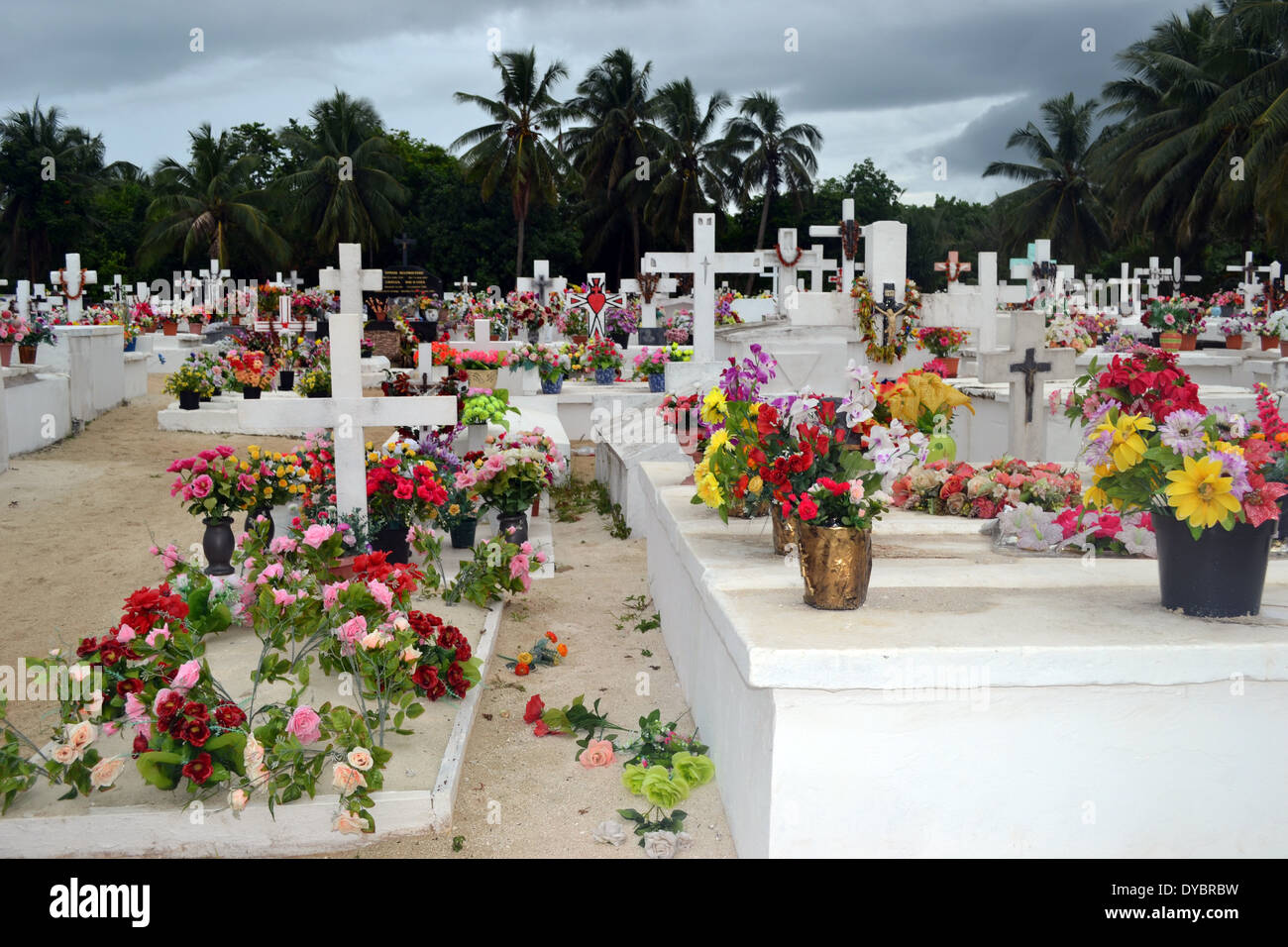 Cemetery covered with flowers, Matautu, Wallis Island, Wallis and Futuna, Melanesia, South Pacific - Stock Image
