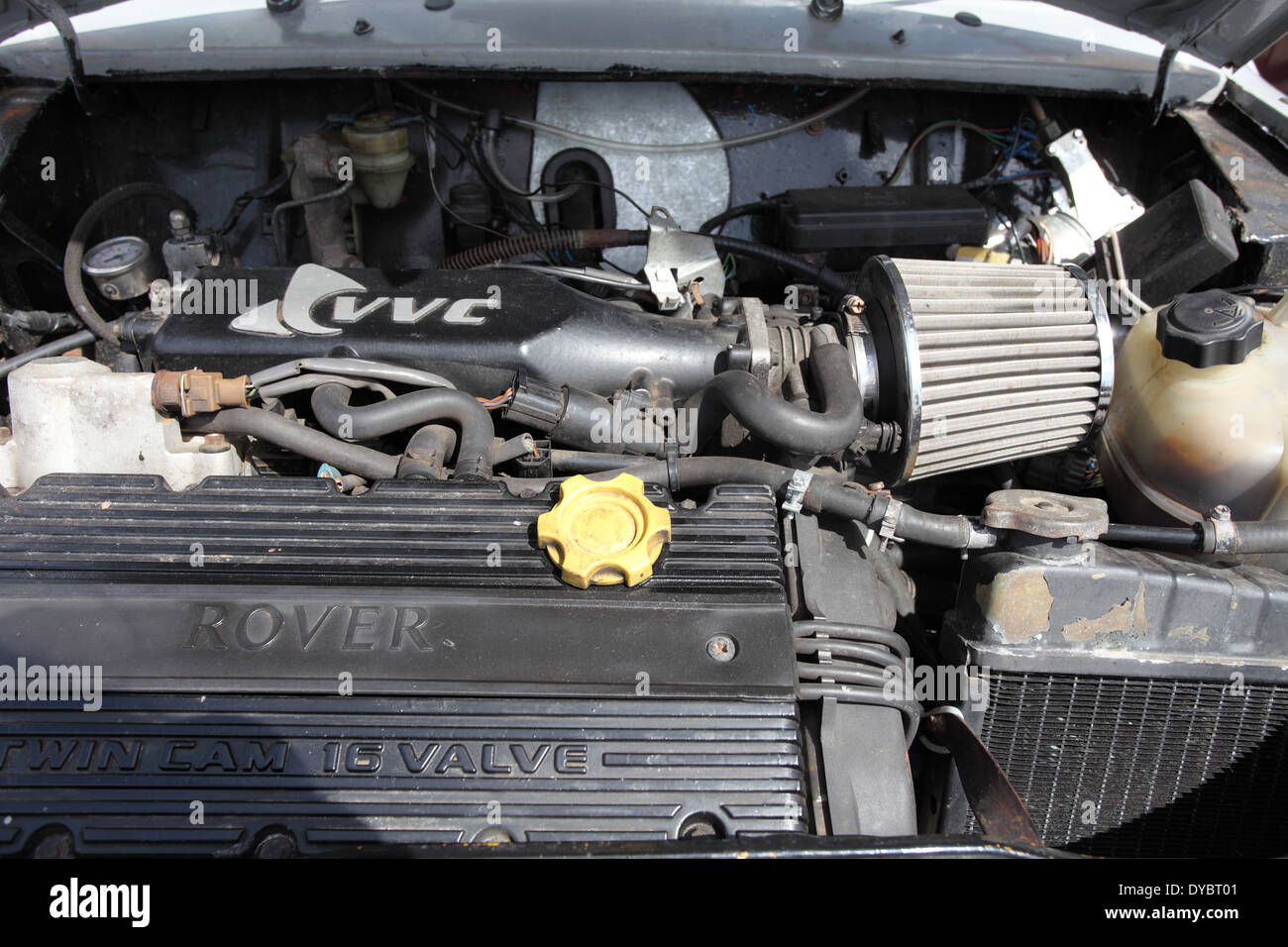 Under The Hood Of A Mini Showing A Rover Twin Cam 16 Valve Engine