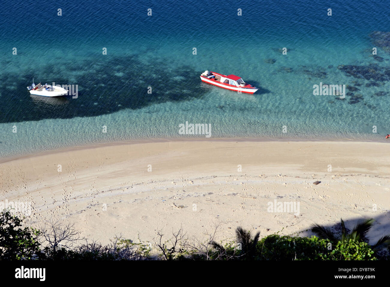 Boats docked in a beach in Nukutapu islet, Wallis Island, Wallis and Futuna, Melanesia, South Pacific - Stock Image