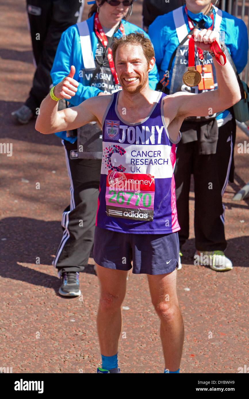 London, UK. 13th April, 2014. Jonny Kane with his the London Marathon 2014 medal Credit:  Keith Larby/Alamy Live News - Stock Image