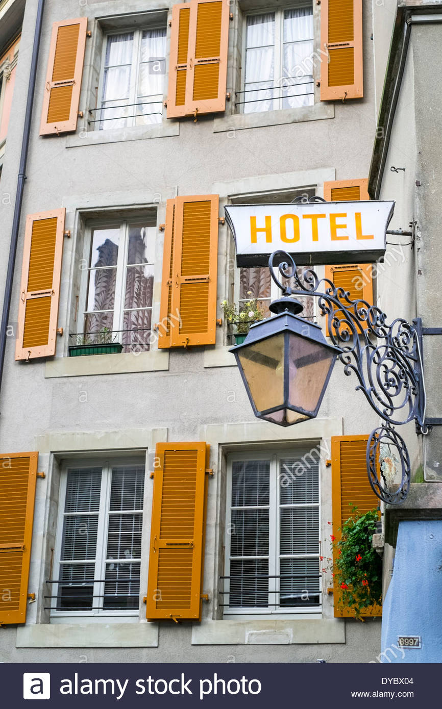 Hotel sign and street lamp, Lausanne, Vaud, Switzerland - Stock Image