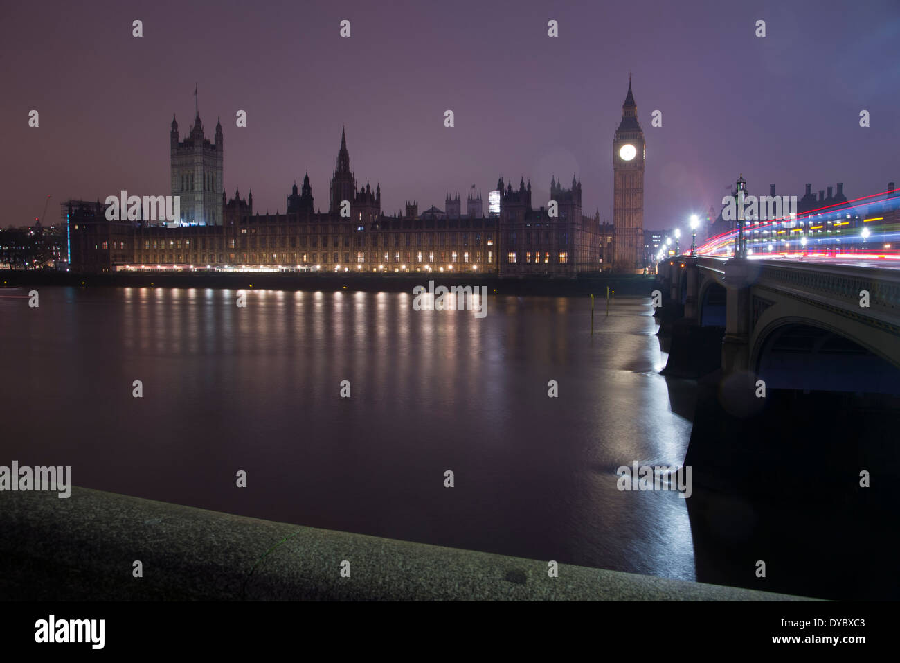 The Houses of Parliament, London - Palace of Westminster, Big Ben and light trails on Westminster Bridge by early Stock Photo