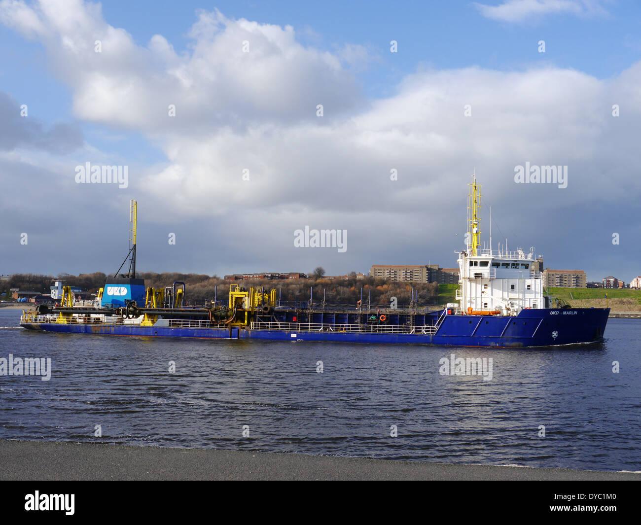 UKD Marlin, a trailing suction hopper dredger, leaving the River Tyne, South Shields, England, UK Stock Photo