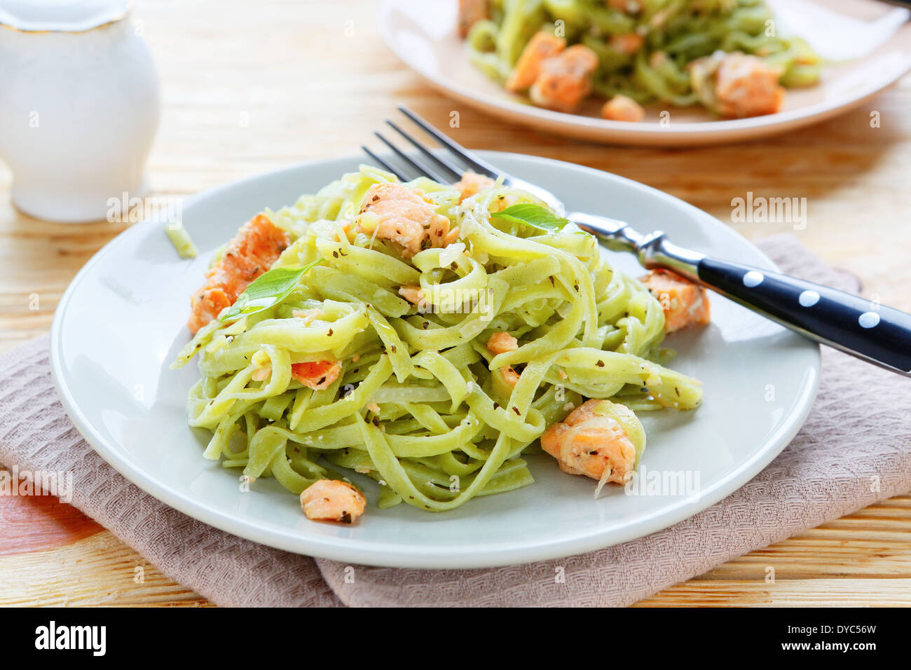 nutritious spinach pasta with salmon, food closeup - Stock Image