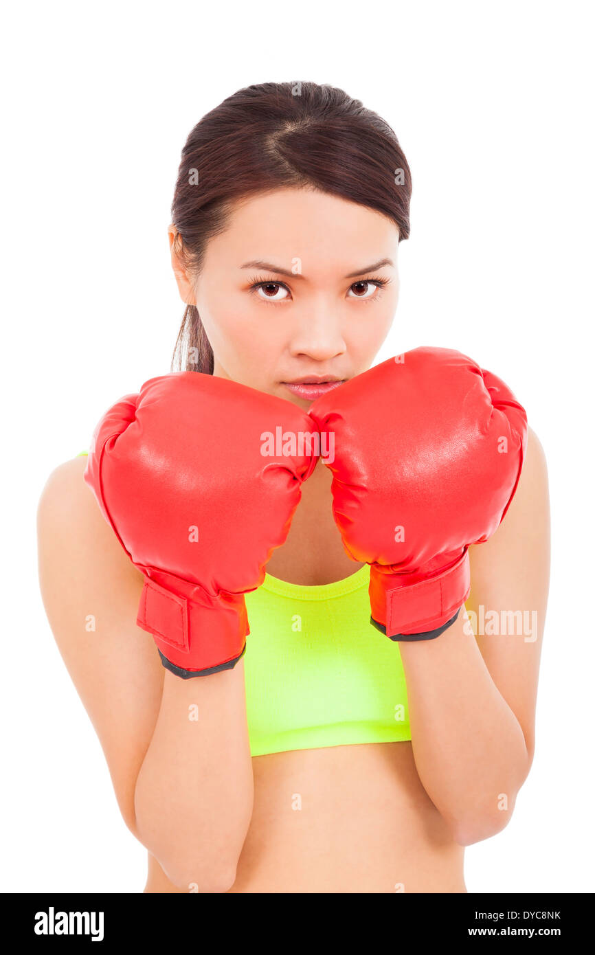 Boxing fitness woman concentrating and protecting pose Stock Photo