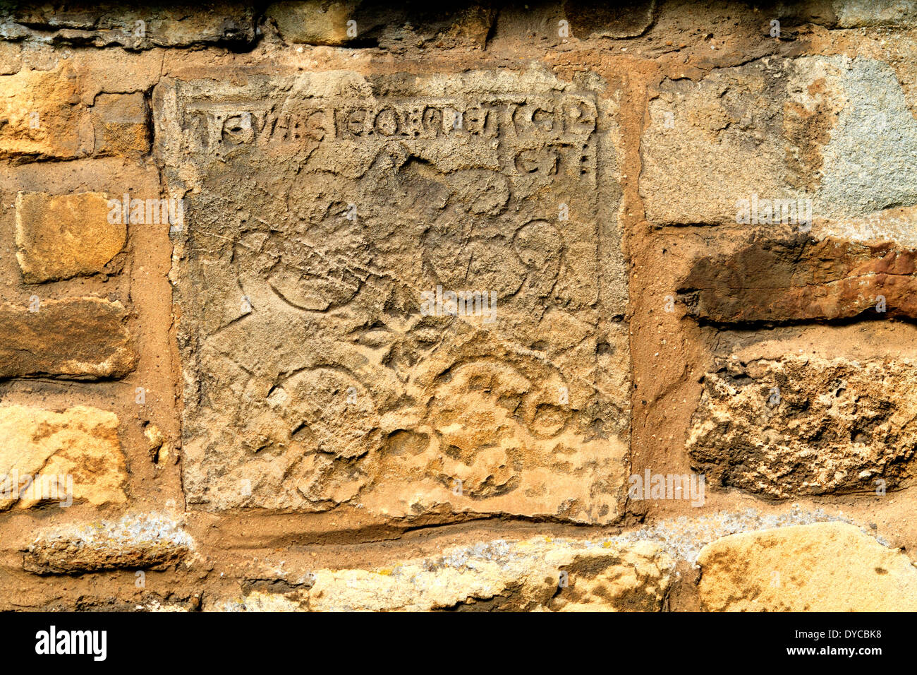 Winteringham all saints church. N E Lincolnshire. Mystery stone set in the church wall, no one seems to know anything about it. - Stock Image