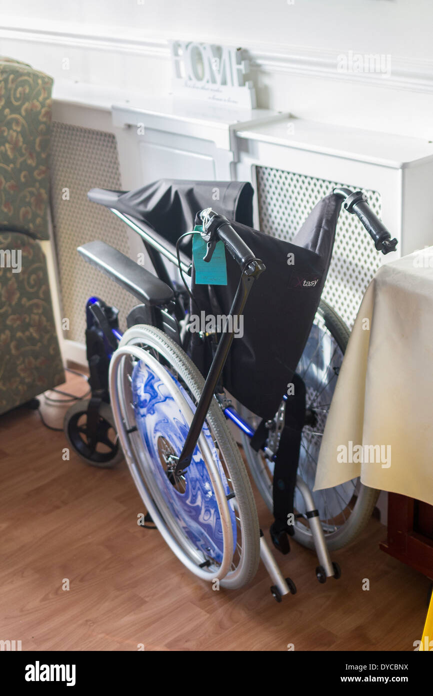 wheelchair in home,folded wheelchair,Adult,Care Colour Image,Grandmother,Human Interest,Love,Nursing Home,Retirement Community,S - Stock Image