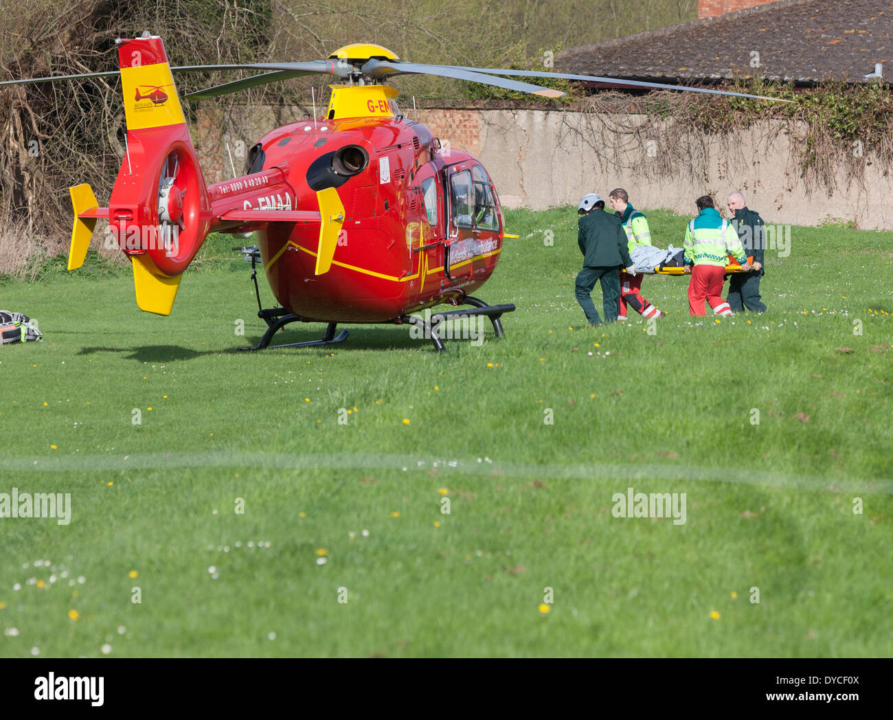 A casualty being lifted aboard the Midlands Air Ambulance. - Stock Image