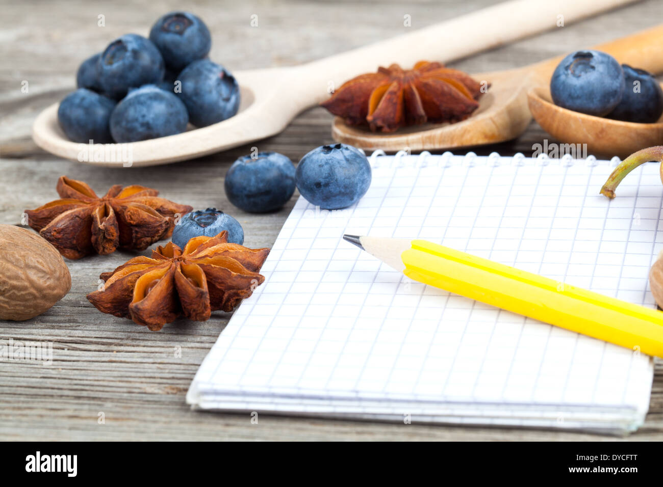 Notebook and pencil with ingredients food on wooden table stock notebook and pencil with ingredients food on wooden table forumfinder Image collections