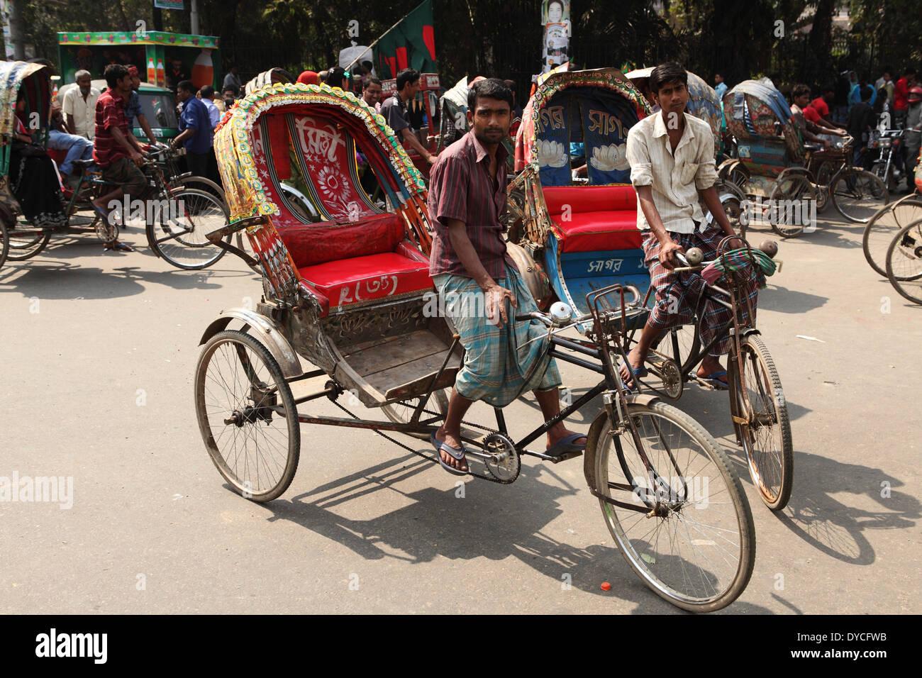 Rickshaw drivers in Dhaka, Bangladesh. - Stock Image