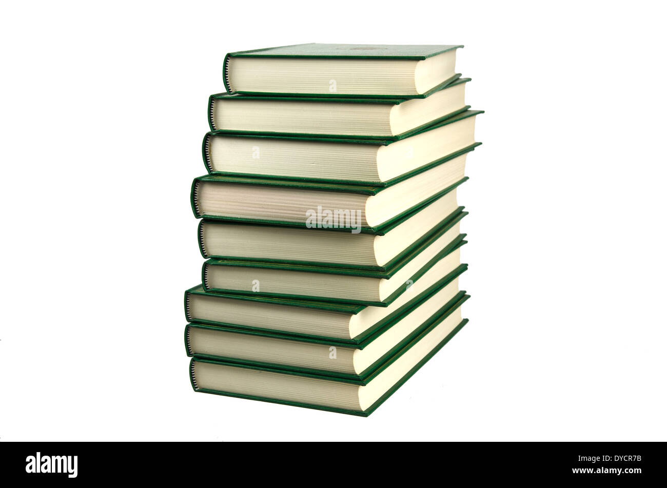 Pile of books with green covers at a white background - Stock Image
