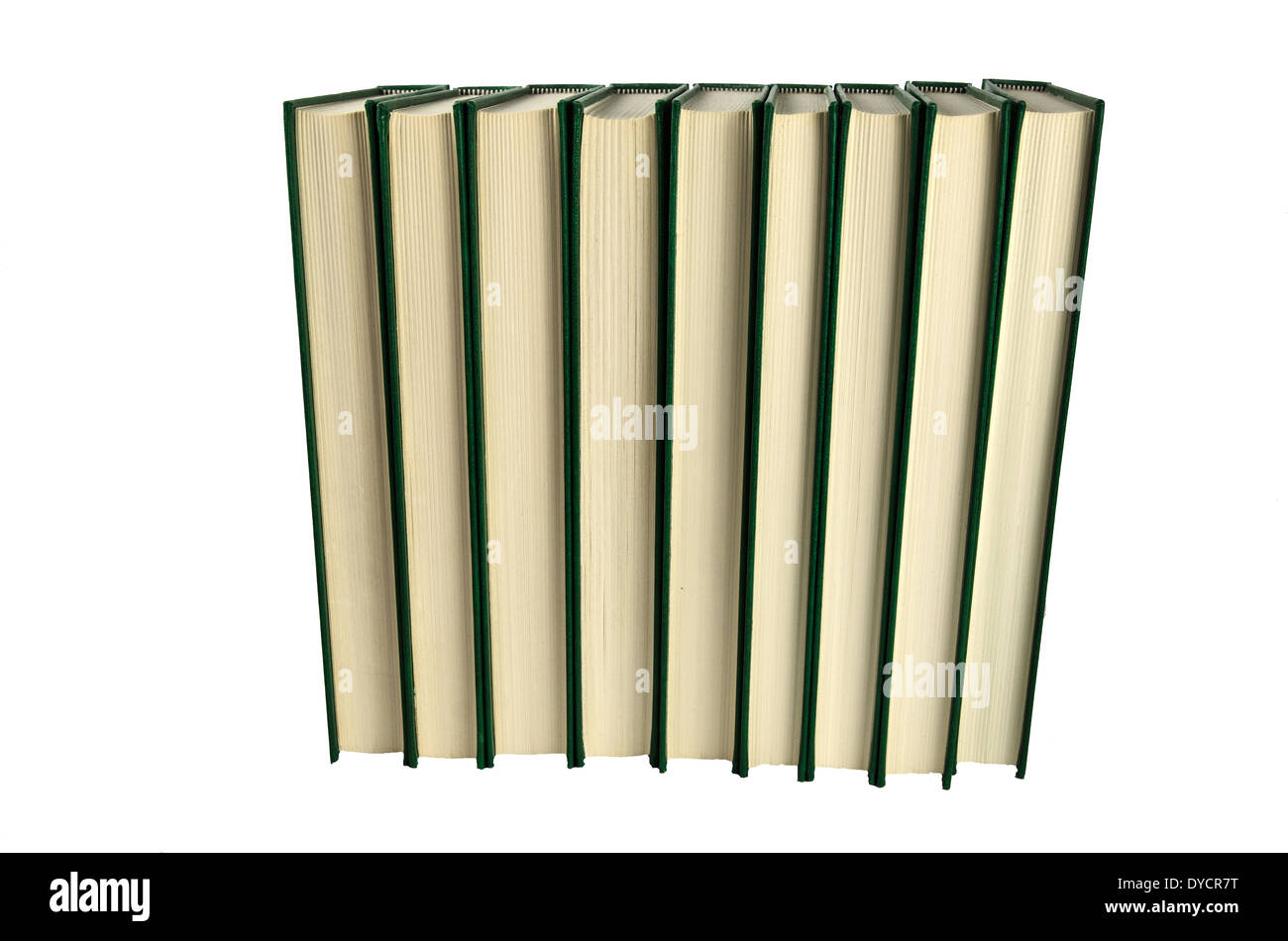 Books standing in a row at white background - Stock Image