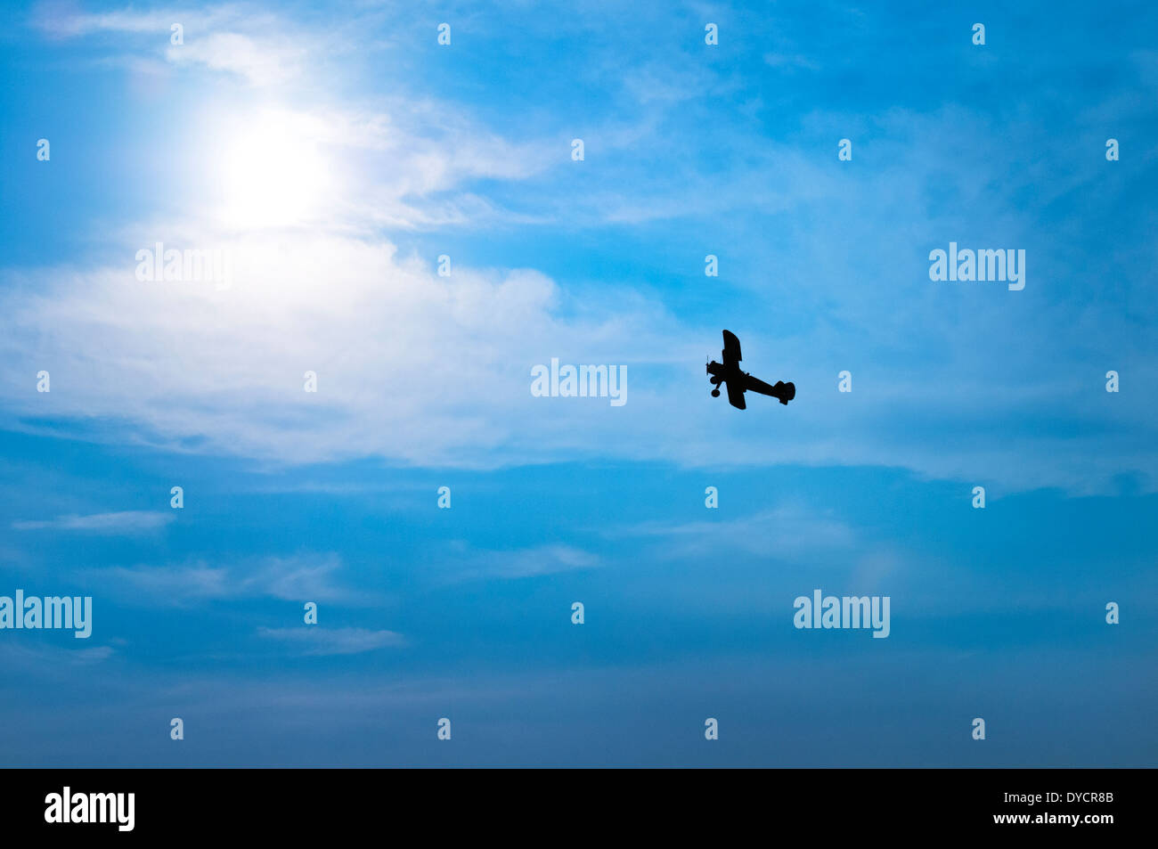 An airplane silhouetted against a hazy blue sky in  Bealeton, Virginia - Stock Image