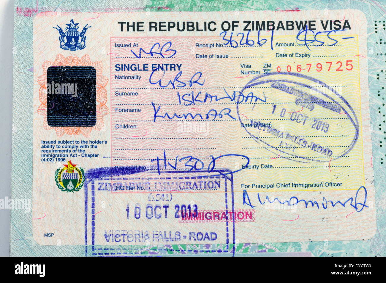 Zimbabwe visa in the passport of a british holiday traveller; African travel - Stock Image