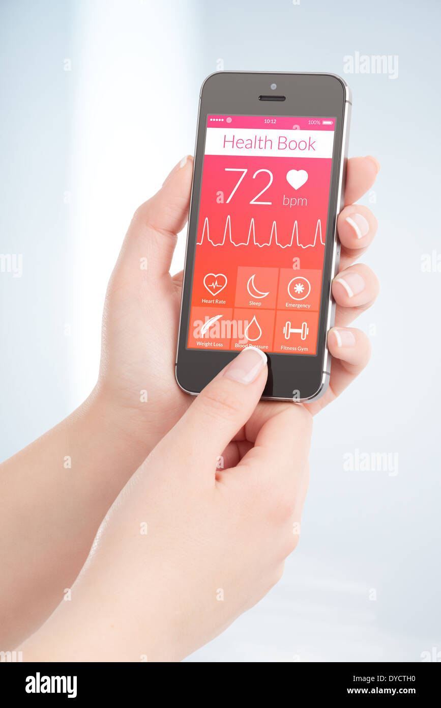 Woman is scanning heartbeat cardiogram by modern smartphone with health book app on the screen. - Stock Image