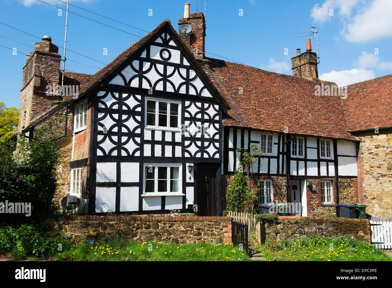 A medieval cottage of various period styles with a tudor black & white frontage in the village of Gomshall, Surrey - Stock Image