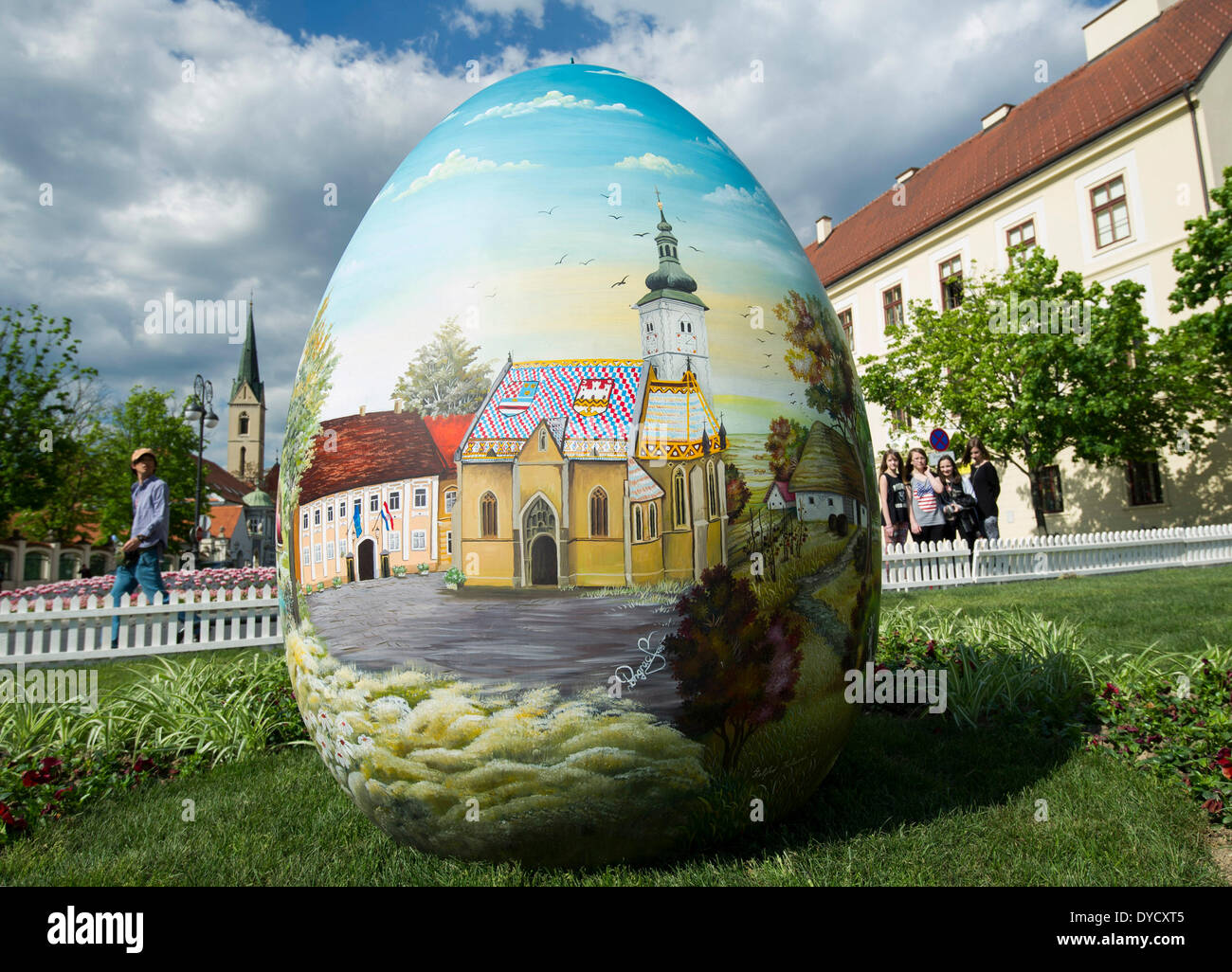Zagreb, Croatia. 14th Apr, 2014. Photo taken on April 14, 2014 shows a huge hand-painted Easter egg on display near the Zagreb Cathedral on Kaptol in Zagreb, capital of Croatia, April 14, 2014. Several Easter eggs, painted in Croatian Naive art style by artists from the Koprivnica-Krizevci County, were set up in downtown Zagreb to celebrate Easter. © Miso Lisanin/Xinhua/Alamy Live News - Stock Image