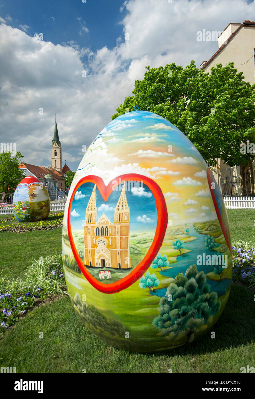 Zagreb, Croatia. 14th Apr, 2014. Photo taken on April 14, 2014 shows huge hand-painted Easter eggs on display near the Zagreb Cathedral on Kaptol in Zagreb, capital of Croatia, April 14, 2014. Several Easter eggs, painted in Croatian Naive art style by artists from the Koprivnica-Krizevci County, were set up in downtown Zagreb to celebrate Easter. © Miso Lisanin/Xinhua/Alamy Live News - Stock Image