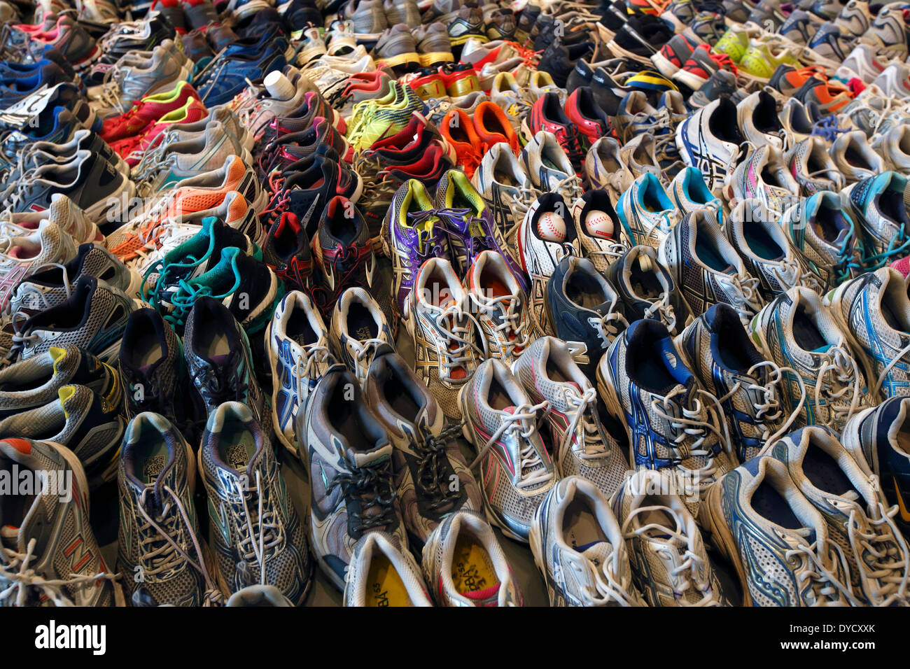 Boston, Massachusetts, USA, 14th April 2014. A collection of running shoes is on display at the Marathon Memorial exhibit in the Boston Public Library. Tuesday marks the one-year anniversary of the Boston Marathon bombings. - Stock Image