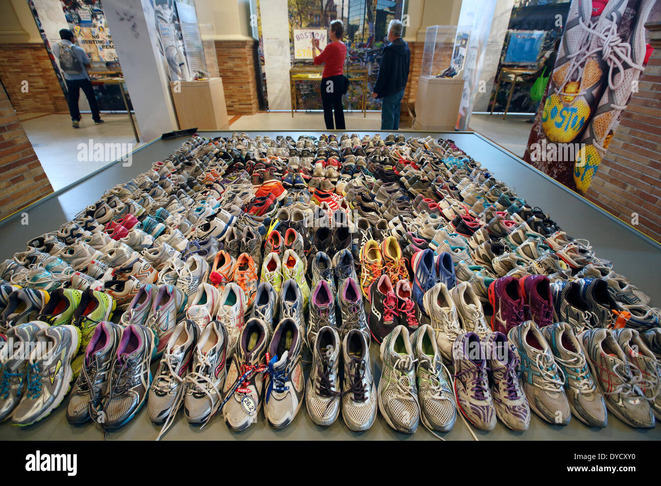 Boston, Massachusetts, USA, 14th April 2014. A collection of running shoes is on display at the Marathon Memorial exhibit in the Boston Public Library. Tuesday, 15th April marks the one-year anniversary of the Boston Marathon bombings. - Stock Image
