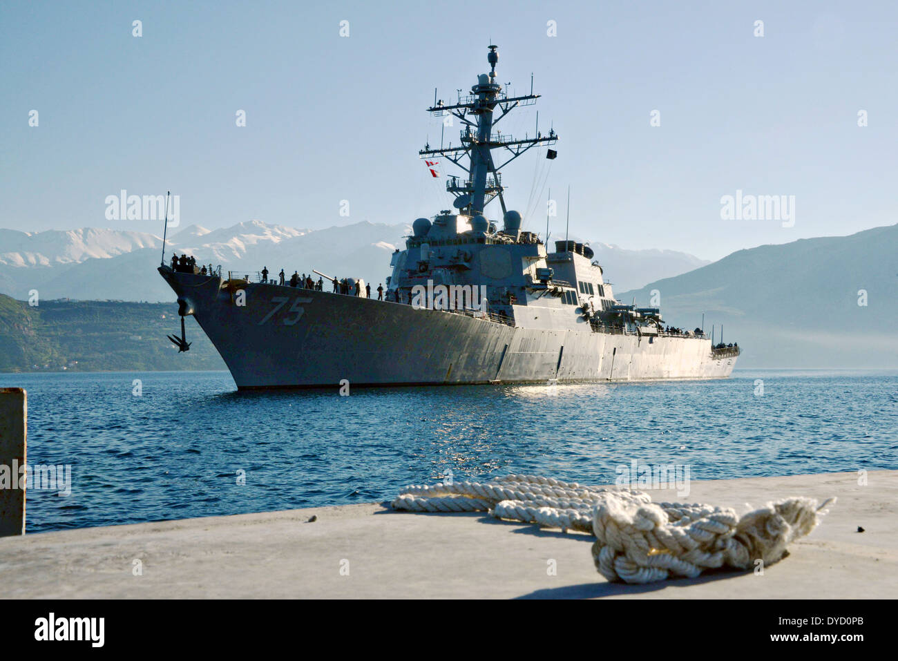 US Navy Arleigh Burke-class guided-missile destroyer USS Donald Cook arrives at Marathi NATO pier facility for a port visit March 18, 2014 in Souda Bay, Greece. - Stock Image