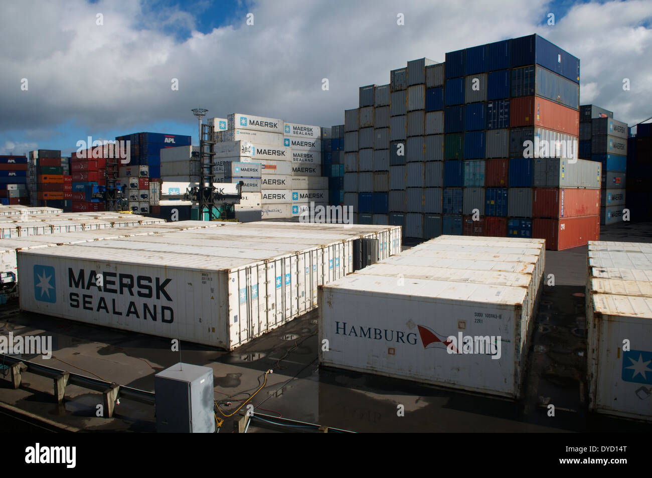 Ocean-going containers stacked and awaiting shipment at Auckland Harbour, New Zealand. - Stock Image