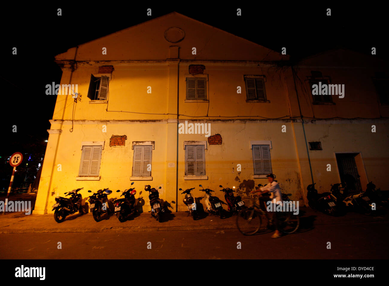 Motorcycles are parked at an old building in Sa Dec, Vietnam - Stock Image
