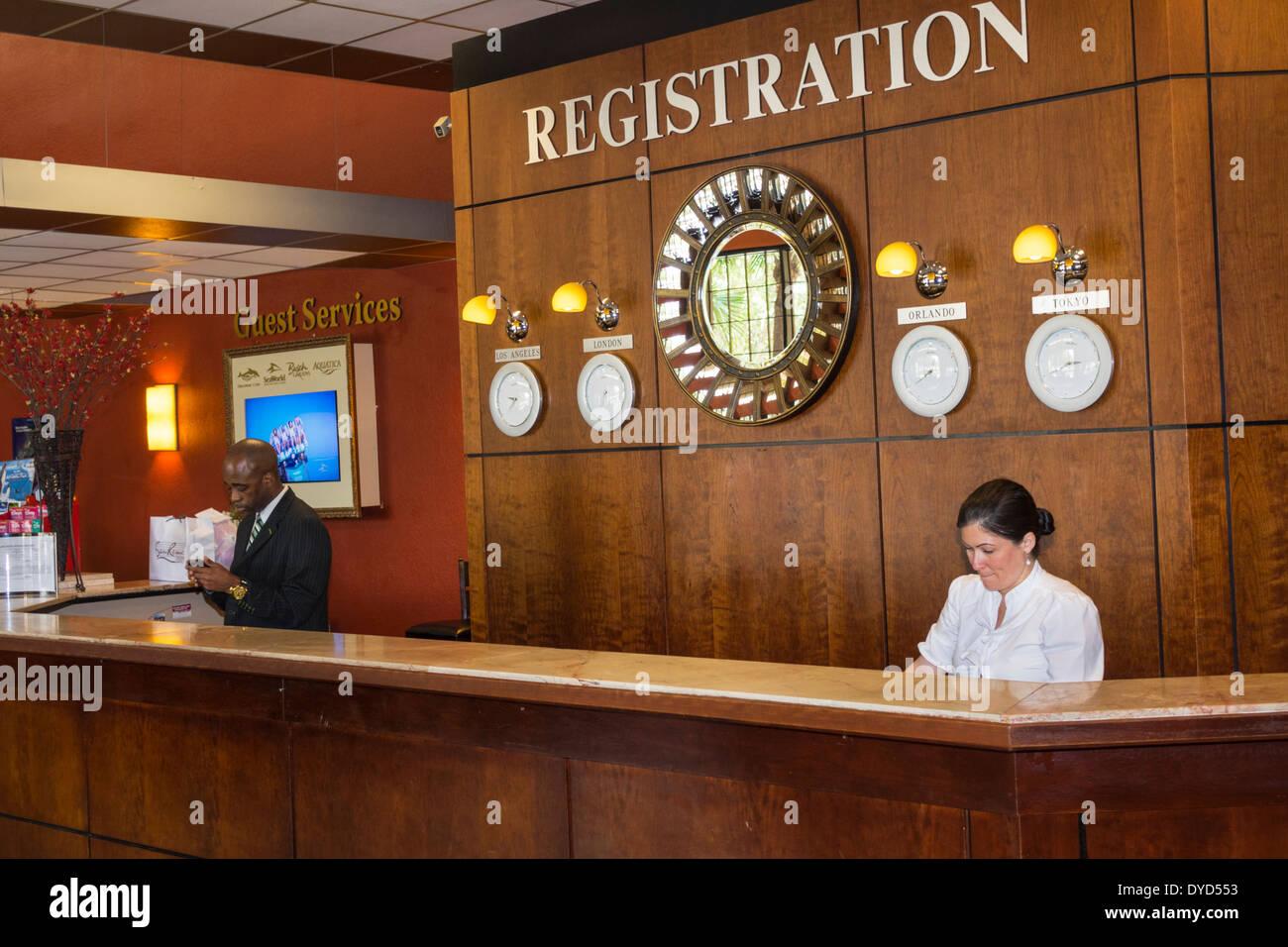 Orlando Florida Allure Resort International Drive Hotel Lobby Front Desk  Reception Registration Asian Woman Black