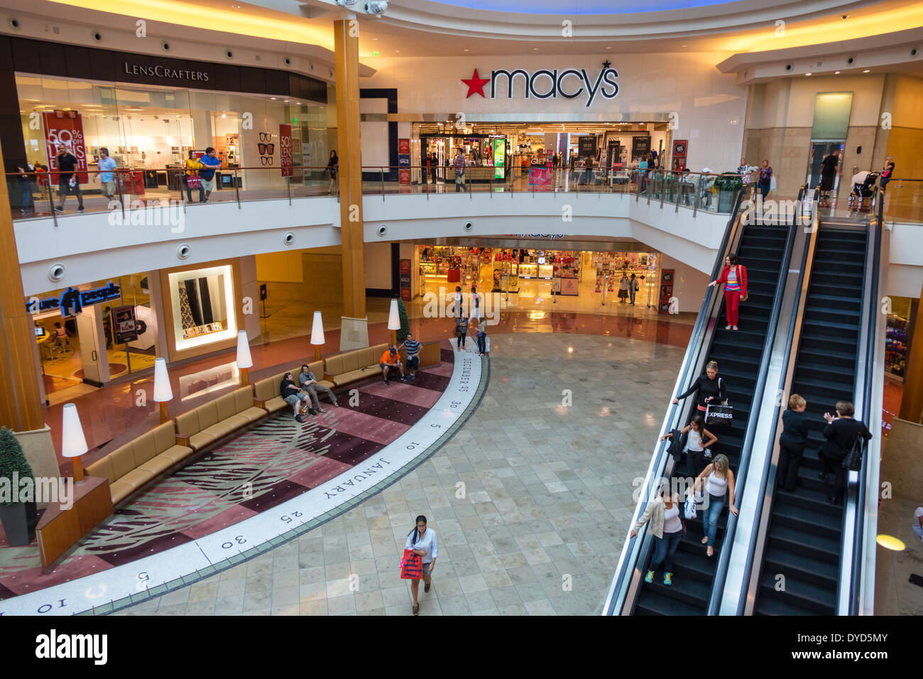 Orlando Florida The Mall at Millenia shopping Macy's Department Store front entrance sign atrium escalators multi level stores businesses - Stock Image