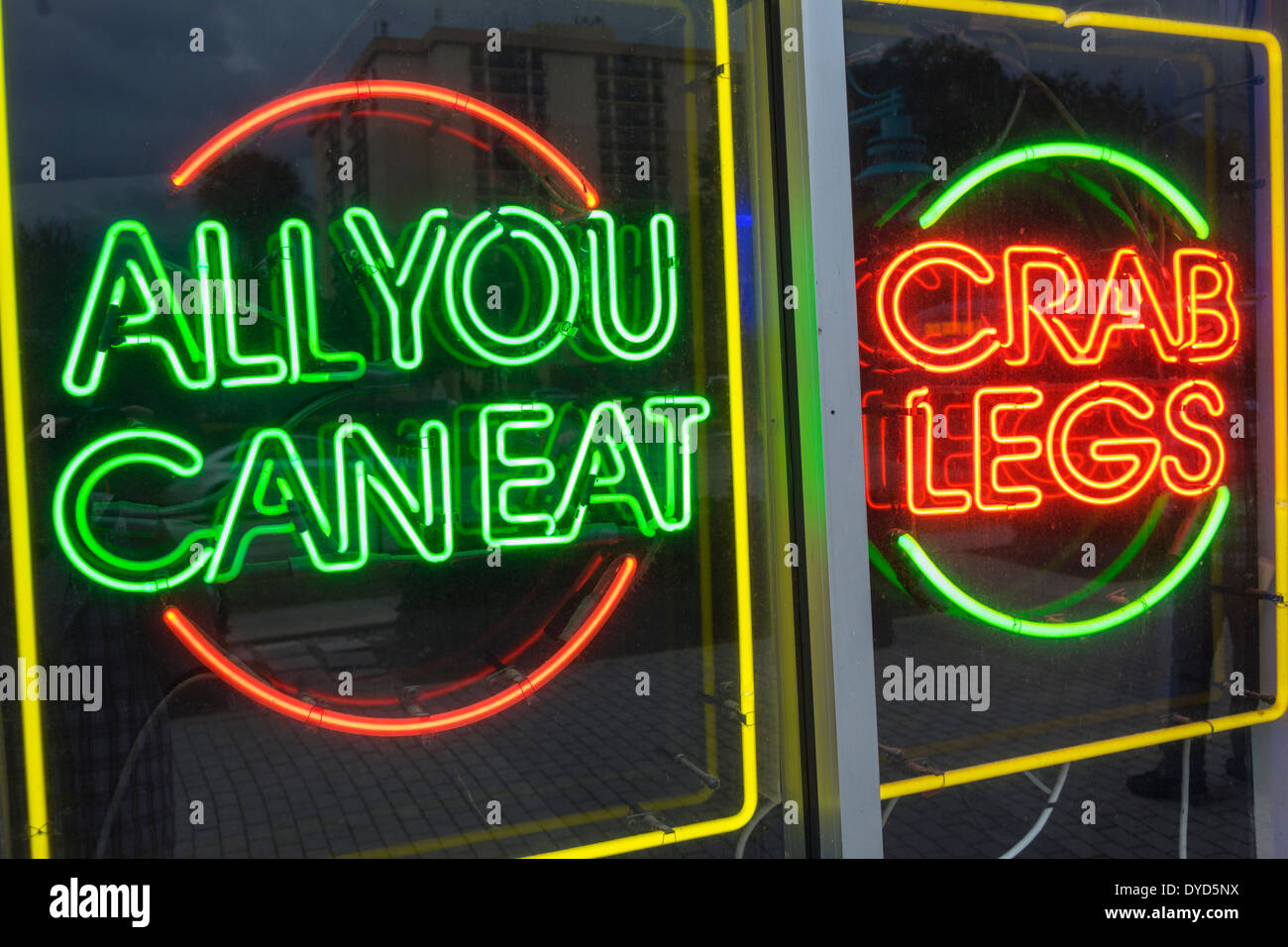 Orlando Florida International Drive neon sign all you can eat restaurant buffet crab legs advertising promotion - Stock Image